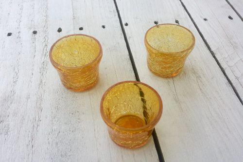 Oranži tējas sveču svečturi